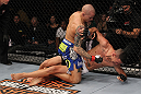 LAS VEGAS, NV - FEBRUARY 04:  Dustin Poirier (blue shorts) delivers punches to Max Holloway from the mount during the UFC 143 event at Mandalay Bay Events Center on February 4, 2012 in Las Vegas, Nevada.  (Photo by Nick Laham/Zuffa LLC/Zuffa LLC via Getty Images) *** Local Caption *** Dustin Poirier; Max Holloway