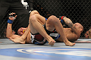 LAS VEGAS, NV - FEBRUARY 04:  Dustin Poirier (right) attempts to submit Max Holloway during the UFC 143 event at Mandalay Bay Events Center on February 4, 2012 in Las Vegas, Nevada.  (Photo by Josh Hedges/Zuffa LLC/Zuffa LLC via Getty Images) *** Local Caption *** Dustin Poirier; Max Holloway