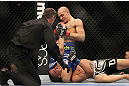 LAS VEGAS, NV - FEBRUARY 04:  Dustin Poirier (blue shorts) attempts to submit Max Holloway during the UFC 143 event at Mandalay Bay Events Center on February 4, 2012 in Las Vegas, Nevada.  (Photo by Josh Hedges/Zuffa LLC/Zuffa LLC via Getty Images) *** Local Caption *** Dustin Poirier