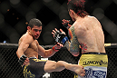 LAS VEGAS, NV - FEBRUARY 04:  Renan Barao (left) kicks Scott Jorgensen during the UFC 143 event at Mandalay Bay Events Center on February 4, 2012 in Las Vegas, Nevada.  (Photo by Josh Hedges/Zuffa LLC/Zuffa LLC via Getty Images) *** Local Caption *** Renan Barao; Scott Jorgensen