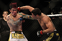 LAS VEGAS, NV - FEBRUARY 04:  Renan Barao (right) punches Scott Jorgensen during the UFC 143 event at Mandalay Bay Events Center on February 4, 2012 in Las Vegas, Nevada.  (Photo by Josh Hedges/Zuffa LLC/Zuffa LLC via Getty Images) *** Local Caption *** Renan Barao; Scott Jorgensen