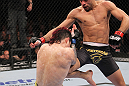 LAS VEGAS, NV - FEBRUARY 04:  Renan Barao (right) knees Scott Jorgensen during the UFC 143 event at Mandalay Bay Events Center on February 4, 2012 in Las Vegas, Nevada.  (Photo by Nick Laham/Zuffa LLC/Zuffa LLC via Getty Images) *** Local Caption *** Renan Barao; Scott Jorgensen