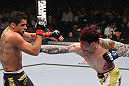 LAS VEGAS, NV - FEBRUARY 04:  Scott Jorgensen (right) punches Renan Barao during the UFC 143 event at Mandalay Bay Events Center on February 4, 2012 in Las Vegas, Nevada.  (Photo by Nick Laham/Zuffa LLC/Zuffa LLC via Getty Images) *** Local Caption *** Scott Jorgensen; Renan Barao