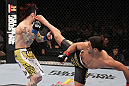 LAS VEGAS, NV - FEBRUARY 04:  Renan Barao (right) kicks Scott Jorgensen during the UFC 143 event at Mandalay Bay Events Center on February 4, 2012 in Las Vegas, Nevada.  (Photo by Nick Laham/Zuffa LLC/Zuffa LLC via Getty Images) *** Local Caption *** Renan Barao; Scott Jorgensen