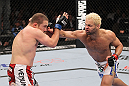 LAS VEGAS, NV - FEBRUARY 04:  Josh Koscheck (right) punches Mike Pierce during the UFC 143 event at Mandalay Bay Events Center on February 4, 2012 in Las Vegas, Nevada.  (Photo by Nick Laham/Zuffa LLC/Zuffa LLC via Getty Images) *** Local Caption *** Josh Koscheck; Mike Pierce