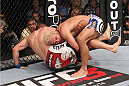 LAS VEGAS, NV - FEBRUARY 04:  Josh Koscheck (right) wrestles Mike Pierce to the ground during the UFC 143 event at Mandalay Bay Events Center on February 4, 2012 in Las Vegas, Nevada.  (Photo by Nick Laham/Zuffa LLC/Zuffa LLC via Getty Images) *** Local Caption *** Josh Koscheck