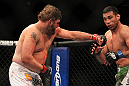 LAS VEGAS, NV - FEBRUARY 04:  Roy Nelson (left) punches Fabricio Werdum during the UFC 143 event at Mandalay Bay Events Center on February 4, 2012 in Las Vegas, Nevada.  (Photo by Josh Hedges/Zuffa LLC/Zuffa LLC via Getty Images) *** Local Caption *** Roy Nelson; Fabricio Werdum