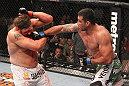 LAS VEGAS, NV - FEBRUARY 04:  Fabricio Werdum (right) punches Roy Nelson during the UFC 143 event at Mandalay Bay Events Center on February 4, 2012 in Las Vegas, Nevada.  (Photo by Nick Laham/Zuffa LLC/Zuffa LLC via Getty Images) *** Local Caption *** Fabricio Werdum