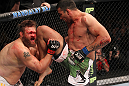 LAS VEGAS, NV - FEBRUARY 04:  Fabricio Werdum (right) knees Roy Nelson during the UFC 143 event at Mandalay Bay Events Center on February 4, 2012 in Las Vegas, Nevada.  (Photo by Nick Laham/Zuffa LLC/Zuffa LLC via Getty Images) *** Local Caption *** Fabricio Werdum; Roy Nelson