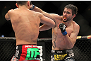 LAS VEGAS - FEBRUARY 04:  Carlos Condit (right) punches Nick Diaz during the UFC 143 event at Mandalay Bay Events Center on February 4, 2012 in Las Vegas, Nevada.  (Photo by Josh Hedges/Zuffa LLC/Zuffa LLC via Getty Images) *** Local Caption *** Carlos Condit; Nick Diaz