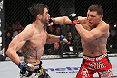 LAS VEGAS - FEBRUARY 04:  (R-L) Nick Diaz punches Carlos Condit during the UFC 143 event at Mandalay Bay Events Center on February 4, 2012 in Las Vegas, Nevada.  (Photo by Nick Laham/Zuffa LLC/Zuffa LLC via Getty Images) *** Local Caption *** Carlos Condit; Nick Diaz