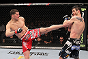 LAS VEGAS - FEBRUARY 04:  (L-R) Nick Diaz kicks Carlos Condit during the UFC 143 event at Mandalay Bay Events Center on February 4, 2012 in Las Vegas, Nevada.  (Photo by Nick Laham/Zuffa LLC/Zuffa LLC via Getty Images) *** Local Caption *** Nick Diaz; Carlos Condit