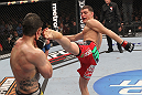 LAS VEGAS - FEBRUARY 04:  (R-L) Nick Diaz kicks Carlos Condit during the UFC 143 event at Mandalay Bay Events Center on February 4, 2012 in Las Vegas, Nevada.  (Photo by Nick Laham/Zuffa LLC/Zuffa LLC via Getty Images) *** Local Caption *** Nick Diaz; Carlos Condit