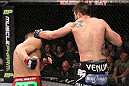 LAS VEGAS - FEBRUARY 04:  Carlos Condit (right) punches Nick Diaz during the UFC 143 event at Mandalay Bay Events Center on February 4, 2012 in Las Vegas, Nevada.  (Photo by Nick Laham/Zuffa LLC/Zuffa LLC via Getty Images) *** Local Caption *** Carlos Condit; Nick Diaz