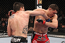 LAS VEGAS - FEBRUARY 04:  Carlos Condit (left) punches Nick Diaz during the UFC 143 event at Mandalay Bay Events Center on February 4, 2012 in Las Vegas, Nevada.  (Photo by Nick Laham/Zuffa LLC/Zuffa LLC via Getty Images) *** Local Caption *** Carlos Condit; Nick Diaz