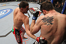 LAS VEGAS - FEBRUARY 04:  Nick Diaz (left) punches Carlos Condit during the UFC 143 event at Mandalay Bay Events Center on February 4, 2012 in Las Vegas, Nevada.  (Photo by Nick Laham/Zuffa LLC/Zuffa LLC via Getty Images) *** Local Caption *** Nick Diaz; Carlos Condit