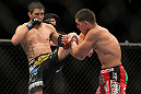 LAS VEGAS - FEBRUARY 04:  Carlos Condit (left) kicks Nick Diaz during the UFC 143 event at Mandalay Bay Events Center on February 4, 2012 in Las Vegas, Nevada.  (Photo by Josh Hedges/Zuffa LLC/Zuffa LLC via Getty Images) *** Local Caption *** Carlos Condit; Nick Diaz