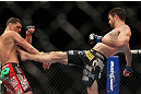 LAS VEGAS - FEBRUARY 04:  (R-L) Carlos Condit kicks Nick Diaz during the UFC 143 event at Mandalay Bay Events Center on February 4, 2012 in Las Vegas, Nevada.  (Photo by Josh Hedges/Zuffa LLC/Zuffa LLC via Getty Images) *** Local Caption *** Carlos Condit; Nick Diaz