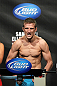 OMAHA, NE - FEBRUARY 14:  TJ Dillashaw weighs in during the UFC on FUEL TV weigh in event at Omaha Civic Auditorium on February 14, 2012 in Omaha, Nebraska.  (Photo by Josh Hedges/Zuffa LLC/Zuffa LLC via Getty Images) *** Local Caption *** TJ Dillashaw