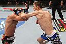 OMAHA, NE - FEBRUARY 15:  (R-L) Tim Means punches Bernardo Magalhaes during the UFC on FUEL TV event at Omaha Civic Auditorium on February 15, 2012 in Omaha, Nebraska.  (Photo by Josh Hedges/Zuffa LLC/Zuffa LLC via Getty Images) *** Local Caption *** Tim Means; Bernardo Magalhaes