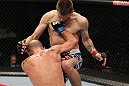 OMAHA, NE - FEBRUARY 15:  (L-R) Bernardo Magalhaes and Tim Means trade strikes during the UFC on FUEL TV event at Omaha Civic Auditorium on February 15, 2012 in Omaha, Nebraska.  (Photo by Josh Hedges/Zuffa LLC/Zuffa LLC via Getty Images) *** Local Caption *** Tim Means; Bernardo Magalhaes