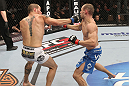 OMAHA, NE - FEBRUARY 15:  (L-R) Justin Salas punches Anton Kuivanen during the UFC on FUEL TV event at Omaha Civic Auditorium on February 15, 2012 in Omaha, Nebraska.  (Photo by Josh Hedges/Zuffa LLC/Zuffa LLC via Getty Images) *** Local Caption *** Anton Kuivanen; Justin Salas