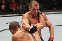 OMAHA, NE - FEBRUARY 15:  (L-R) Justin Salas and Anton Kuivanen trade punches during the UFC on FUEL TV event at Omaha Civic Auditorium on February 15, 2012 in Omaha, Nebraska.  (Photo by Josh Hedges/Zuffa LLC/Zuffa LLC via Getty Images) *** Local Caption *** Anton Kuivanen; Justin Salas