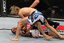 OMAHA, NE - FEBRUARY 15:  (R-L) Jonathan Brookins knocks out Vagner Rocha with a punch on the ground during the UFC on FUEL TV event at Omaha Civic Auditorium on February 15, 2012 in Omaha, Nebraska.  (Photo by Josh Hedges/Zuffa LLC/Zuffa LLC via Getty Images) *** Local Caption *** Jonathan Brookins; Vagner Rocha