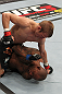 OMAHA, NE - FEBRUARY 15:  TJ Dillashaw punches down at Walel Watson on the ground during the UFC on FUEL TV event at Omaha Civic Auditorium on February 15, 2012 in Omaha, Nebraska.  (Photo by Josh Hedges/Zuffa LLC/Zuffa LLC via Getty Images) *** Local Caption *** TJ Dillashaw; Walel Watson