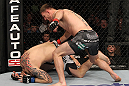 OMAHA, NE - FEBRUARY 15:  (R-L) Stipe Miocic punches Phil De Fries during the UFC on FUEL TV event at Omaha Civic Auditorium on February 15, 2012 in Omaha, Nebraska.  (Photo by Josh Hedges/Zuffa LLC/Zuffa LLC via Getty Images) *** Local Caption *** Stipe Miocic; Phil De Fries