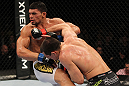 OMAHA, NE - FEBRUARY 15:  (R-L) Aaron Simpson punches Ronny Markes during the UFC on FUEL TV event at Omaha Civic Auditorium on February 15, 2012 in Omaha, Nebraska.  (Photo by Josh Hedges/Zuffa LLC/Zuffa LLC via Getty Images) *** Local Caption *** Aaron Simpson; Ronny Markes