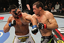 OMAHA, NE - FEBRUARY 15:  (R-L) Aaron Simpson and Ronny Markes trade punches during the UFC on FUEL TV event at Omaha Civic Auditorium on February 15, 2012 in Omaha, Nebraska.  (Photo by Josh Hedges/Zuffa LLC/Zuffa LLC via Getty Images) *** Local Caption *** Aaron Simpson; Ronny Markes