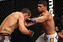 OMAHA, NE - FEBRUARY 15:  (R-L) Ronny Markes punches Aaron Simpson during the UFC on FUEL TV event at Omaha Civic Auditorium on February 15, 2012 in Omaha, Nebraska.  (Photo by Josh Hedges/Zuffa LLC/Zuffa LLC via Getty Images) *** Local Caption *** Aaron Simpson; Ronny Markes