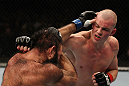 OMAHA, NE - FEBRUARY 15:  (R-L) Stefan Struve punches Dave Herman during the UFC on FUEL TV event at Omaha Civic Auditorium on February 15, 2012 in Omaha, Nebraska.  (Photo by Josh Hedges/Zuffa LLC/Zuffa LLC via Getty Images) *** Local Caption *** Stefan Struve; Dave Herman