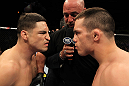 OMAHA, NE - FEBRUARY 15:  Opponents Diego Sanchez (L) and Jake Ellenberger (R) face off before their main event bout during the UFC on FUEL TV event at Omaha Civic Auditorium on February 15, 2012 in Omaha, Nebraska.  (Photo by Josh Hedges/Zuffa LLC/Zuffa LLC via Getty Images) *** Local Caption *** Jake Ellenberger; Diego Sanchez