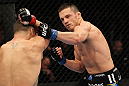 OMAHA, NE - FEBRUARY 15:  (R-L) Jake Ellenberger punches Diego Sanchez during the UFC on FUEL TV event at Omaha Civic Auditorium on February 15, 2012 in Omaha, Nebraska.  (Photo by Josh Hedges/Zuffa LLC/Zuffa LLC via Getty Images) *** Local Caption *** Jake Ellenberger; Diego Sanchez