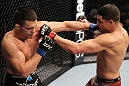 OMAHA, NE - FEBRUARY 15:  (L-R) Jake Ellenberger and Diego Sanchez trade punches during the UFC on FUEL TV event at Omaha Civic Auditorium on February 15, 2012 in Omaha, Nebraska.  (Photo by Josh Hedges/Zuffa LLC/Zuffa LLC via Getty Images) *** Local Caption *** Jake Ellenberger; Diego Sanchez