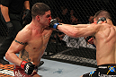 OMAHA, NE - FEBRUARY 15:  (L-R) Diego Sanchez and Jake Ellenberger trade punches during the UFC on FUEL TV event at Omaha Civic Auditorium on February 15, 2012 in Omaha, Nebraska.  (Photo by Josh Hedges/Zuffa LLC/Zuffa LLC via Getty Images) *** Local Caption *** Jake Ellenberger; Diego Sanchez