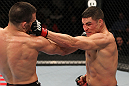 OMAHA, NE - FEBRUARY 15:  (R-L) Diego Sanchez and Jake Ellenberger trade punches during the UFC on FUEL TV event at Omaha Civic Auditorium on February 15, 2012 in Omaha, Nebraska.  (Photo by Josh Hedges/Zuffa LLC/Zuffa LLC via Getty Images) *** Local Caption *** Jake Ellenberger; Diego Sanchez