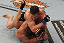 OMAHA, NE - FEBRUARY 15:  Jake Ellenberger delivers an elbow strike against Diego Sanchez during the UFC on FUEL TV event at Omaha Civic Auditorium on February 15, 2012 in Omaha, Nebraska.  (Photo by Josh Hedges/Zuffa LLC/Zuffa LLC via Getty Images) *** Local Caption *** Jake Ellenberger; Diego Sanchez