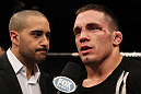 OMAHA, NE - FEBRUARY 15:  Jake Ellenberger (R) is interviewed by Jon Anik after his victory over Diego Sanchez during the UFC on FUEL TV event at Omaha Civic Auditorium on February 15, 2012 in Omaha, Nebraska.  (Photo by Josh Hedges/Zuffa LLC/Zuffa LLC via Getty Images) *** Local Caption *** Jake Ellenberger; Jon Anik