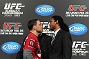 TOKYO, JAPAN - FEBRUARY 23:  (L-R) UFC Lightweight Champion Frankie Edgar and challenger Benson Henderson face off at the final UFC 144 pre-fight press conference at the Ritz-Carlton Hotel on February 23, 2012 in Tokyo, Japan.  (Photo by Josh Hedges/Zuffa LLC/Zuffa LLC via Getty Images) *** Local Caption *** Frankie Edgar; Benson Henderson