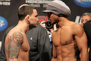 SAITAMA, JAPAN - FEBRUARY 25:  (L-R) UFC Lightweight Champion Frankie Edgar and challenger Benson Henderson face off after weighing in during the official UFC 144 weigh in at the Saitama Super Arena on February 25, 2012 in Saitama, Japan.  (Photo by Josh Hedges/Zuffa LLC/Zuffa LLC via Getty Images) *** Local Caption *** Benson Henderson; Frankie Edgar