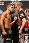SAITAMA, JAPAN - FEBRUARY 25:  (L-R) Lightweight opponents Anthony Pettis and Joe Lauzon face off after weighing in during the official UFC 144 weigh in at the Saitama Super Arena on February 25, 2012 in Saitama, Japan.  (Photo by Josh Hedges/Zuffa LLC/Zuffa LLC via Getty Images) *** Local Caption *** Anthony Pettis; Joe Lauzon
