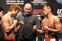 SAITAMA, JAPAN - FEBRUARY 25:  (L-R) Lightweight opponents Takanori Gomi and Eiji Mitsuoka face off after weighing in during the official UFC 144 weigh in at the Saitama Super Arena on February 25, 2012 in Saitama, Japan.  (Photo by Josh Hedges/Zuffa LLC/Zuffa LLC via Getty Images) *** Local Caption *** Takanori Gomi; Eiji Mitsuoka
