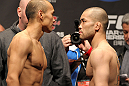 SAITAMA, JAPAN - FEBRUARY 25:  (L-R) Opponents Tiequan Zhang and Issei Tamura face off after weighing in during the official UFC 144 weigh in at the Saitama Super Arena on February 25, 2012 in Saitama, Japan.  (Photo by Josh Hedges/Zuffa LLC/Zuffa LLC via Getty Images) *** Local Caption *** Tiequan Zhang; Issei Tamura