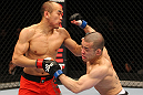 SAITAMA, JAPAN - FEBRUARY 26:  (R-L) Issei Tamura delivers a punch that knocks down Tiequan Zhang during the UFC 144 event at Saitama Super Arena on February 26, 2012 in Saitama, Japan.  (Photo by Al Bello/Zuffa LLC/Zuffa LLC via Getty Images) *** Local Caption *** Tiequan Zhang; Issei Tamura