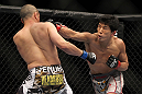 SAITAMA, JAPAN - FEBRUARY 26:  (R-L) Takeya Mizugaki punches Chris Cariaso during the UFC 144 event at Saitama Super Arena on February 26, 2012 in Saitama, Japan.  (Photo by Josh Hedges/Zuffa LLC/Zuffa LLC via Getty Images) *** Local Caption *** Takeya Mizugaki; Chris Cariaso