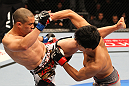 SAITAMA, JAPAN - FEBRUARY 26:  (L-R) Chris Cariaso and Takeya Mizugaki trade strikes during the UFC 144 event at Saitama Super Arena on February 26, 2012 in Saitama, Japan.  (Photo by Al Bello/Zuffa LLC/Zuffa LLC via Getty Images) *** Local Caption *** Takeya Mizugaki; Chris Cariaso