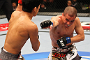 SAITAMA, JAPAN - FEBRUARY 26:  (R-L) Chris Cariaso punches Takeya Mizugaki during the UFC 144 event at Saitama Super Arena on February 26, 2012 in Saitama, Japan.  (Photo by Al Bello/Zuffa LLC/Zuffa LLC via Getty Images) *** Local Caption *** Takeya Mizugaki; Chris Cariaso